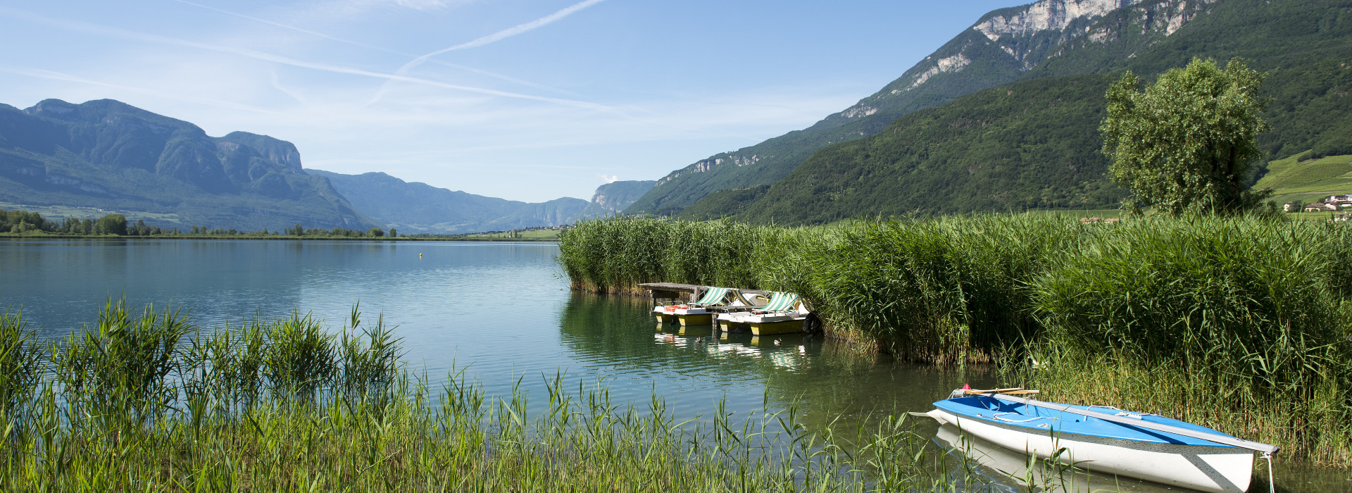 Boote am Kalterer See: Urlaub im Hotel Kaltern